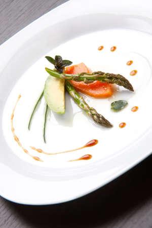 Closeup of Tapas Salad appetizer with avocado, asparagus, papaya, chocolate mint and chives.