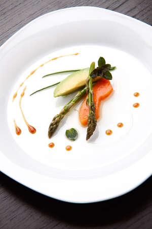 Closeup of Tapas Salad appetizer with avocado, asparagus, papaya, chocolate mint and chives. photo