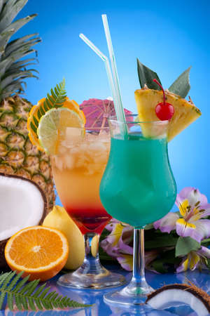 Closeup of Mai Tai and Blue Hawaiian cocktails surrounded by tropical fruits. Most popular cocktails series. photo