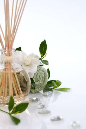 gardenia: Aromatic spa set - Reed Diffuser and fresh gardenia flowers. Stock Photo
