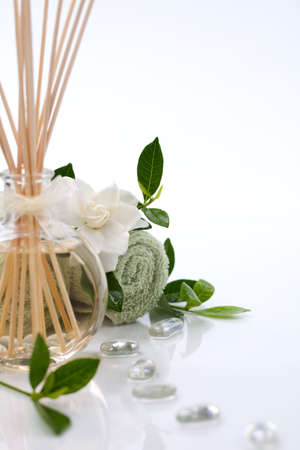 Aromatic spa set - Reed Diffuser and fresh gardenia flowers. Stock Photo