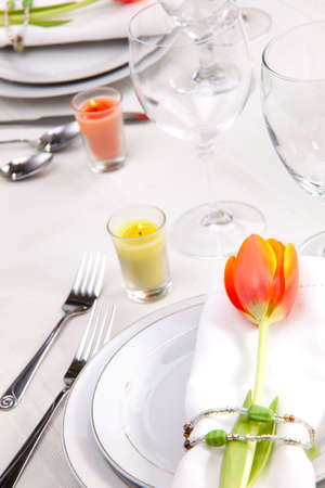 Fine food and wine spring table settings with fresh tulips