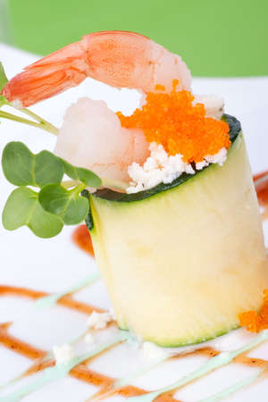 Zucchini Roll with shrimps and seasoned capelin roe (Masago). Garnished with wasabi sauce.