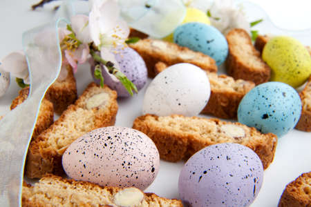 Closeup of assorted almond biscuits and Easter eggs photo