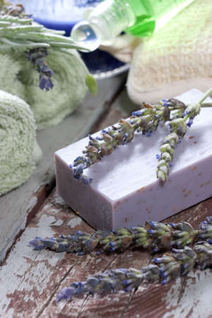 Spa set - fresh lavender and organic lavender soap over old wooden tray. best suited for relaxing and health commercials photo