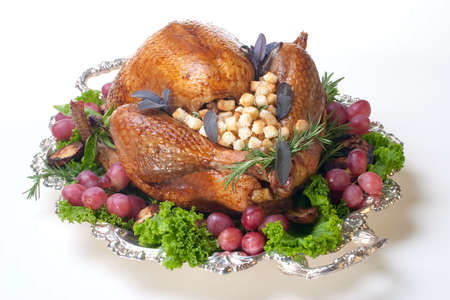 veggie tray: Garnished roasted turkey on platter over white background