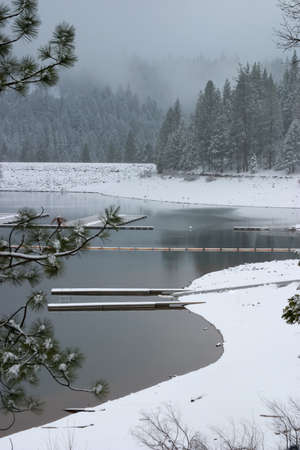 white winter: Nice view to winter lake hidden inside mountains snow covered Stock Photo