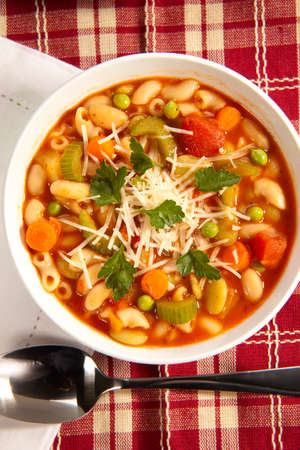 Closeup of bowl of hot fresh Minestrone soup photo