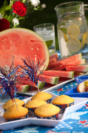 cornbread: Cornbread and hot dogs on 4th of July in patriotic theme Stock Photo