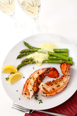 Closeup of delicious grilled lobster tails served with asparagus and bearnaise sauce Stock Photo - 7080663