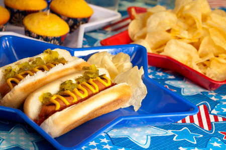 Hot dogs and cornbread on 4th of July in patriotic theme photo