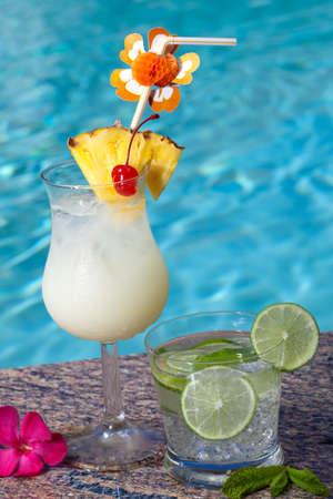 Pina Colada and Mojito cocktails on swimming pool side Stock Photo - 7164683