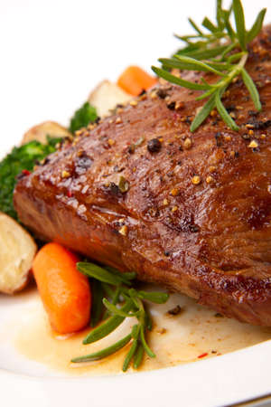 seasoned: Roasted beef loin tri-tip, garnished with vegetables Stock Photo