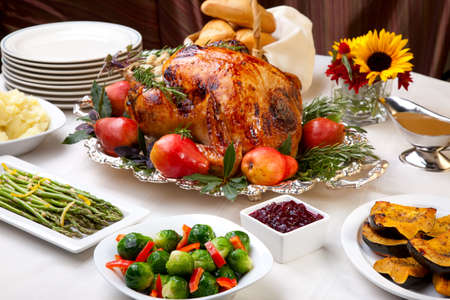 thanksgiving turkey: Delicious roasted turkey with savory vegetable side dishes in a fall theme