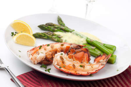 lobster dinner: Closeup of delicious grilled lobster tails served with asparagus and bearnaise sauce