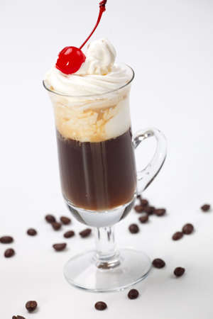 maraschino: Closeup of tasty B-52 Coffee Cocktail, Baileys, Grand Marnier, Kahlua, coffee, whipped cream and maraschino cherry - Coffee Warmers series Stock Photo