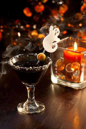 Closeup of Scary Martini, black vodka, vermouth, garnished with olive - Halloween drinks series Stock Photo