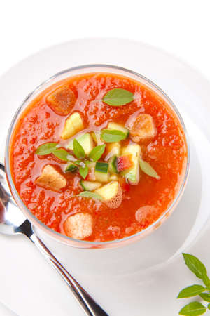 gazpacho: Closeup of a bowl of delicious cold Gazpacho soup with cucumber - avocado salsa. Good summer time appetizer. Stock Photo