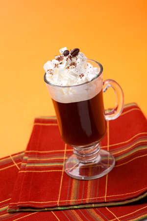 baileys: Closeup of tasty Cafe Royal Cocktail, Baileys, Drambuie, Tia Maria, coffee and whipped cream - Coffee Warmers series Stock Photo