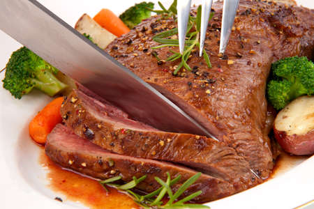 sirloin steak: Roasted beef loin tri-tip, garnished with vegetables Stock Photo