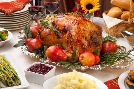 Delicious roasted turkey with savory vegetable side dishes in a fall theme photo