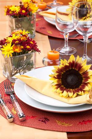 arrangment: Harvest festive dinner table setting with sunflowers.