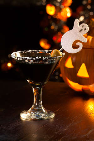 vermouth: Closeup of Scary Martini, black vodka, vermouth, garnished with olive - Halloween drinks series Stock Photo