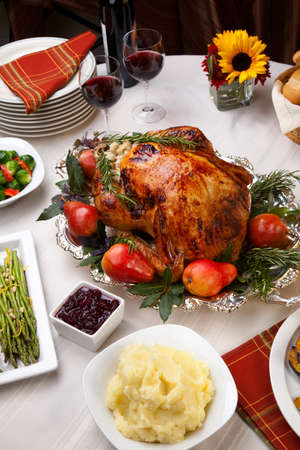 thanksgiving dinner: Delicious roasted turkey with savory vegetable side dishes in a fall theme
