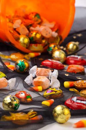 wizard hat: Scatter Halloween candies over Wizard hat