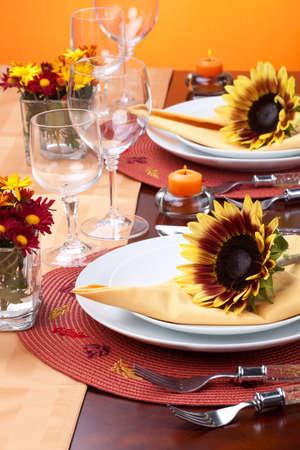 Harvest festive dinner table setting with sunflowers. Stock Photo - 8067064