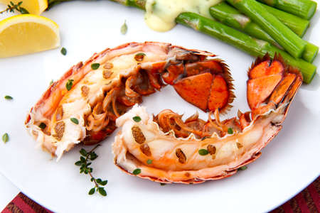 lobsters: Closeup of delicious grilled lobster tails served with asparagus and bearnaise sauce