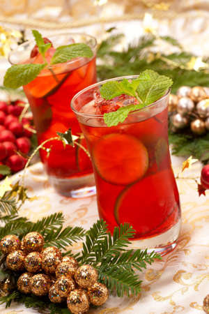 Two Pink Mojito cocktails and Christmas ornaments 写真素材