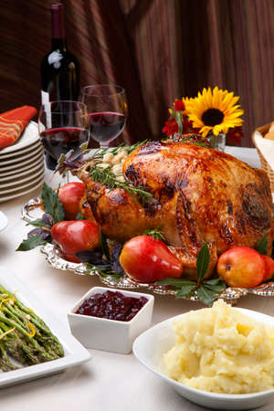 Delicious roasted turkey with savory vegetable side dishes in a fall theme Stock Photo - 8192418