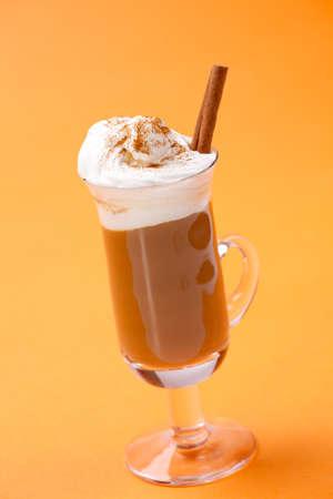 Closeup of tasty Spicy Cinnamon Cocktail - Kahlua, coffee, ground cinnamon and whipped cream - Coffee Warmers series Stock Photo - 8225570