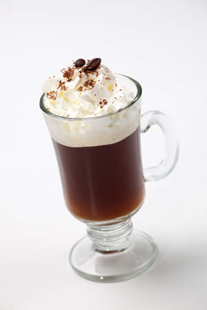 Closeup of tasty Cafe Royal Cocktail, Baileys, Drambuie, Tia Maria, coffee and whipped cream - Coffee Warmers series Stock Photo