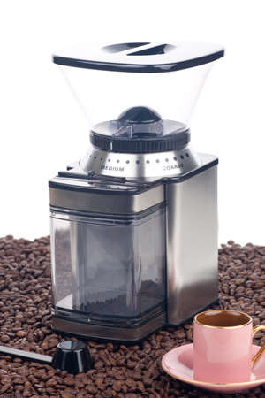 Closeup of modern coffee grinder with coffee beans around over white Stock Photo - 8536135