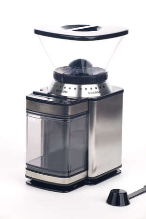 Closeup of modern coffee grinder with coffee beans around over white Stock Photo - 8536126