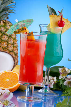 pineapple  glass: Blue Hawaiian and Hurricane cocktails. Most popular cocktails series. Stock Photo