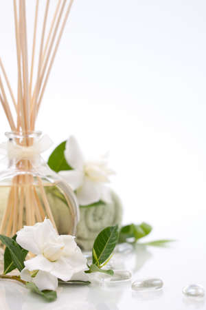 reeds: Aromatic spa set - Reed Diffuser and fresh gardenia flowers. Stock Photo