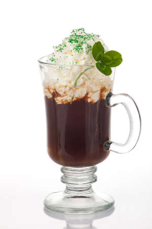 irish culture: Mug of Irish Coffee with green sprinkles and clover leaf for St Paticks Day Stock Photo