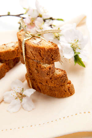 Closeup of assorted almond biscuits and almond flowers photo