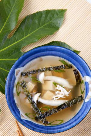 seaweeds: Closeup of bowl of miso soup with mushrooms, seaweeds and tofu.