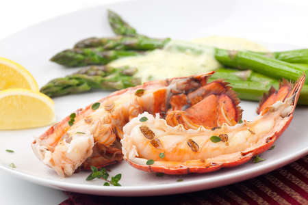 lobster: Closeup of delicious grilled lobster tails served with asparagus and bearnaise sauce