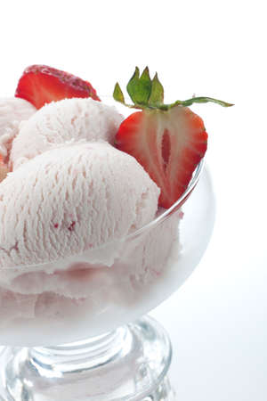 sundae: Closeup of delicious Fruit Ice Cream with fresh strawberries. Stock Photo