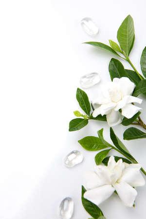 gardenia: Closeup of gardenia flowers with glass stones over white background