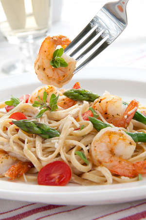 pasta fork: Healthy whole grain linguine with shrimps, asparagus, cherry tomatoes, fresh Parmesan cheese, and  oregano.