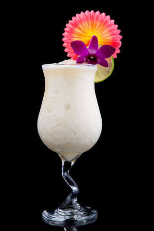 garnish: Banana Daiquiri cocktails. Rum, banana, liqueur, lime juice garnished with lime and orchid flower over black background. Most popular cocktails series.