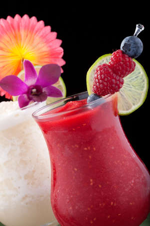 daiquiri alcohol: Banana and Raspberry Daiquiri cocktails. Rum, banana, raspberry, liqueur, lime juice garnished with lime and orchid flower over black background. Most popular cocktails series.