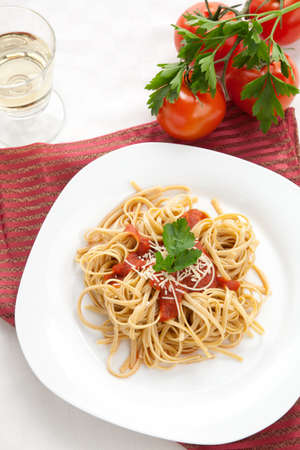 Healthy whole grain linguine with tomato sauce, fresh Parmesan cheese, and  parsley. photo