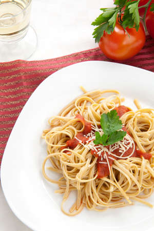 Healthy whole grain linguine with tomato sauce, fresh Parmesan cheese, and  parsley.